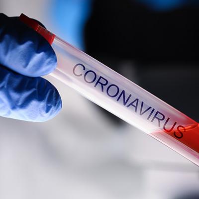 Chemist holding Coronavirus test tube