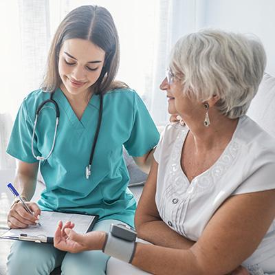 Nurse helping Elder woman