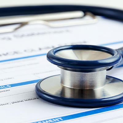 Stethoscope on Health Insurance Form