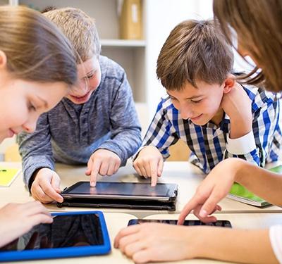 Children on tablet in school