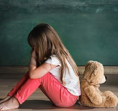 Little Girl alone on floor