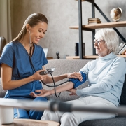 Nurse Caring for Elder Woman