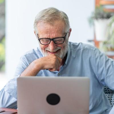Elder Man Using Tech