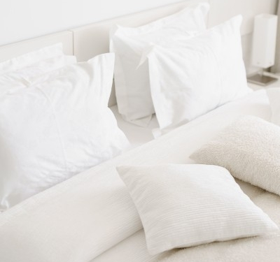 Sheets and Pillows on Bed